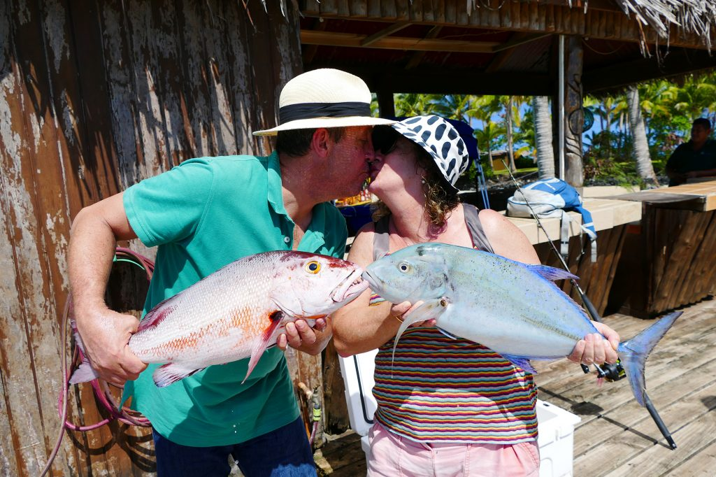 happy couple fishing at Le Vasa Resort